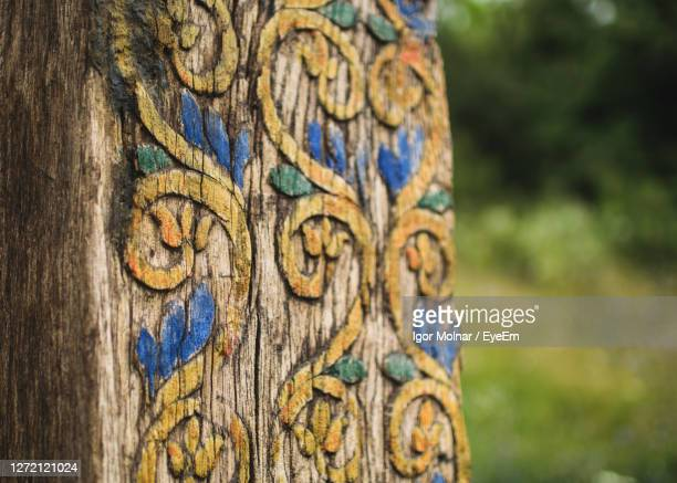 close-up of carving on tree - tree trunk stock pictures, royalty-free photos & images