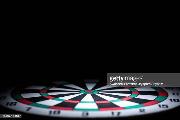close-up of casino table against black background - apuestas deportivas fotografías e imágenes de stock