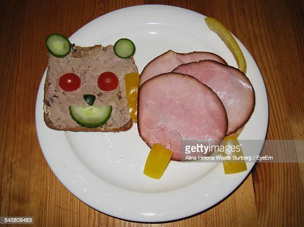 Close-Up Of Cat Made From Sandwich On Plate