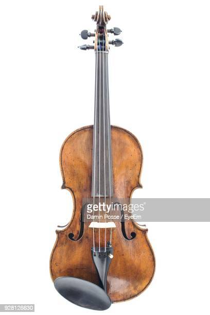 close-up of cello over white background - string instrument stock photos and pictures