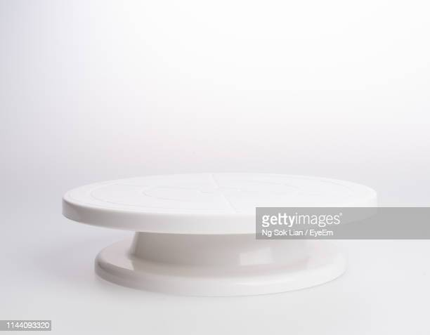 close-up of ceramics cakestand over white background - cakestand stock pictures, royalty-free photos & images