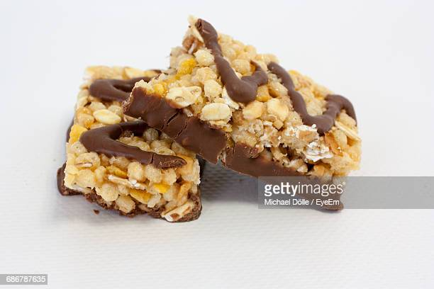 Close-Up Of Cereal Bar On White Background