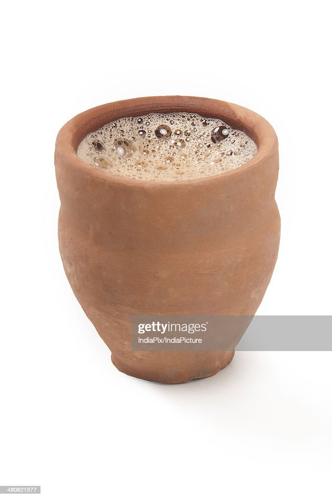 Close-up of chai in traditional cup made of clay isolated over white background : Stock Photo