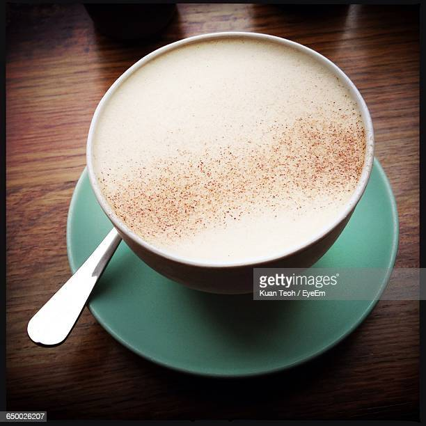 close-up of chai latte on table - chai stock photos and pictures