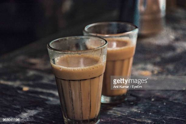 close-up of chai on table - chai stock photos and pictures