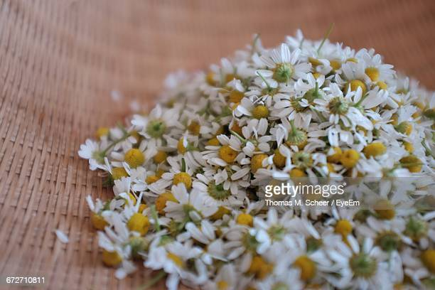 Close-Up Of Chamomile Flowers In Wicker Container