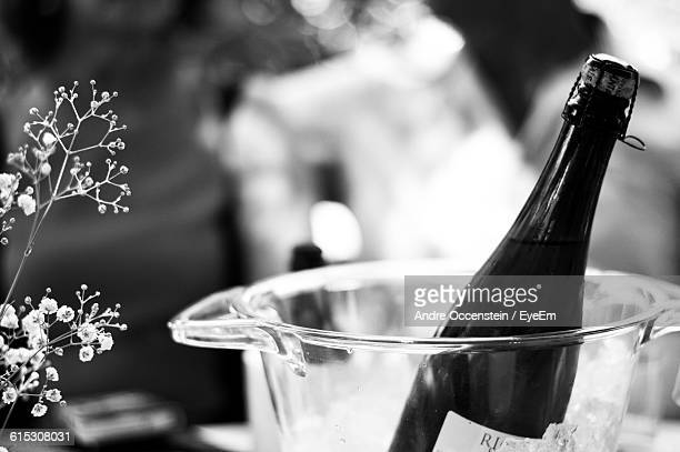 Close-Up Of Champagne Bottle In Glass Container