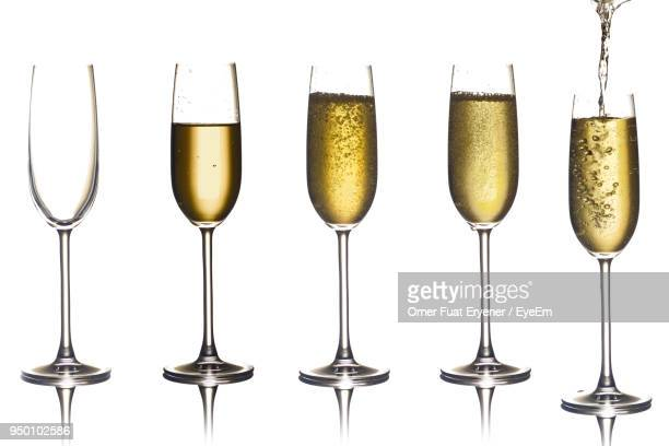 close-up of champagne flute against white - champagne flute stock pictures, royalty-free photos & images