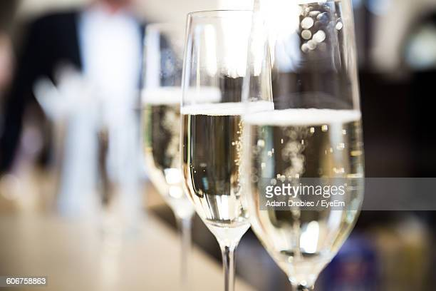 close-up of champagne flutes on table - champagne stock pictures, royalty-free photos & images