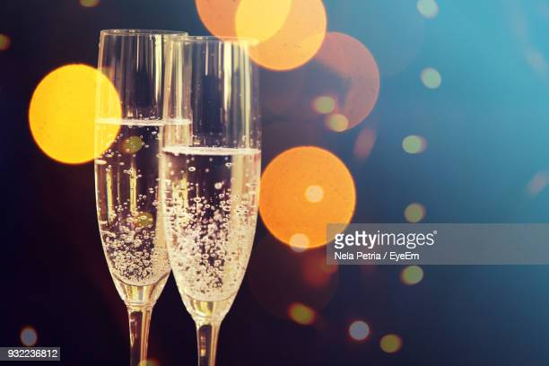 close-up of champagne in champagne flutes - champagne flute stock pictures, royalty-free photos & images