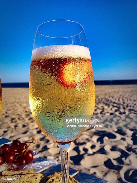 Close-Up Of Champagne On Table At Beach