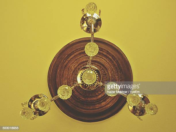 close-up of chandelier hanging from ceiling - nazar stock photos and pictures