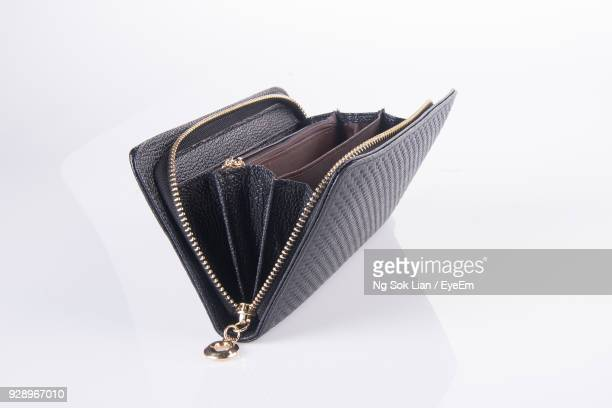 Close-Up Of Change Purse Against White Background
