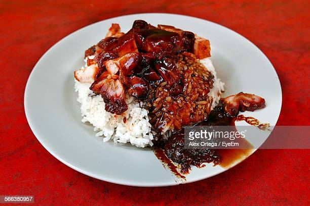 Close-Up Of Char Siu Served With Rice On Table At Restaurant