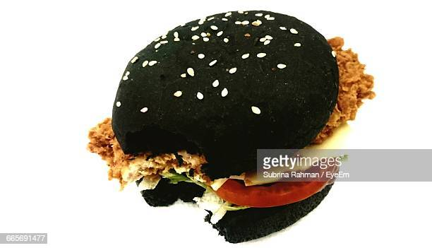 Close-Up Of Charcoal Burger On White Background