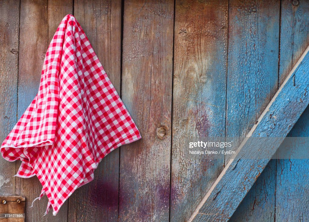 Close-Up Of Checked Napkin Against Wood : Photo