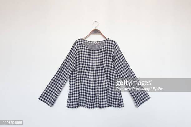 close-up of checked top against white background - bluse stock-fotos und bilder