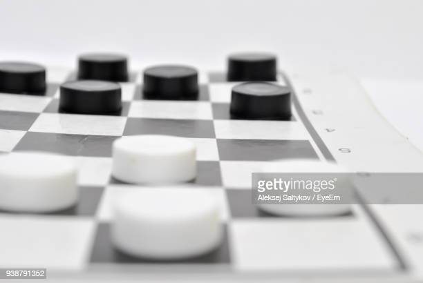 close-up of checkers against white background - chequers stock photos and pictures