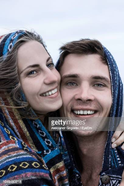 Close-Up Of Cheerful Couple Standing Outdoors