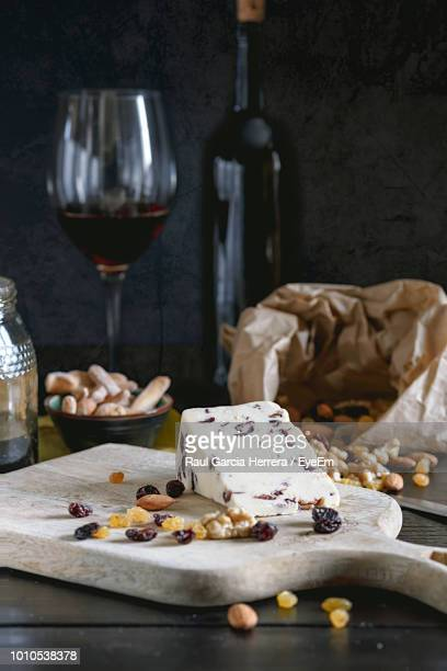 close-up of cheese and nuts on serving board - rich garcia stock-fotos und bilder