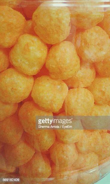 Close-Up Of Cheese Balls In Glass Jar