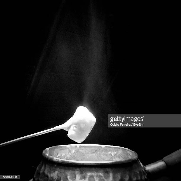 Close-Up Of Cheese Fondue Against Black Background