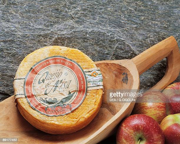 Close-up of cheese in a wooden scoop