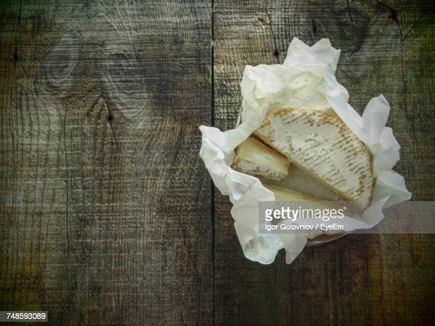 Close-Up Of Cheese On Paper