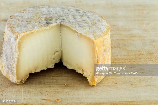 close-up of cheese on wooden table - cammarata stock photos and pictures
