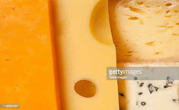 close-up of cheese slices - cheese stock pictures, royalty-free photos & images