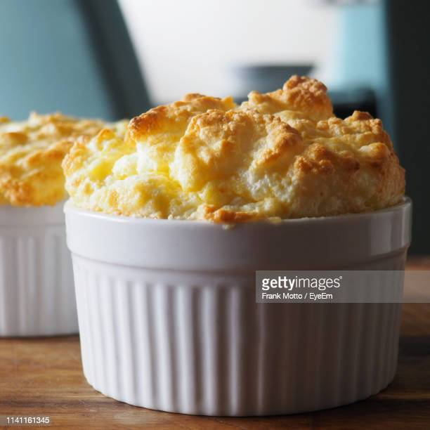 close-up of cheese souffle on table - soufflé stock-fotos und bilder
