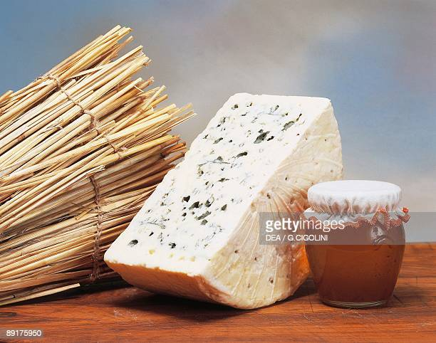 Closeup of cheese with dried sticks