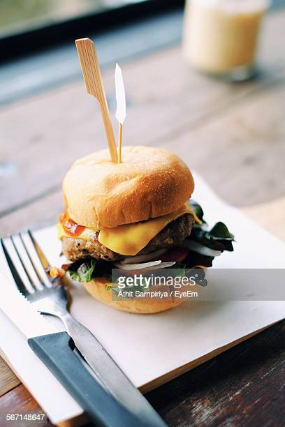 Close-Up Of Cheeseburger Served In Plate On Table
