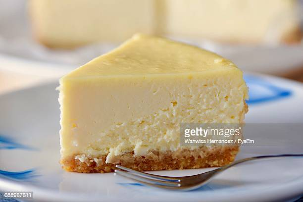 close-up of cheesecake served on table - cheesecake stock pictures, royalty-free photos & images