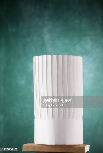 close-up of chef hat on table - chef's hat stock pictures, royalty-free photos & images