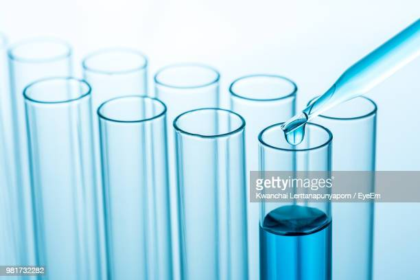 close-up of chemicals in test tube at laboratory - laboratory glassware stock pictures, royalty-free photos & images