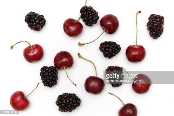 Close-Up Of Cherries And Blackberries On White Background