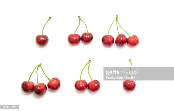 Close-Up Of Cherries Arranged On White Background