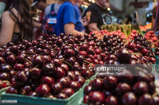 Close-Up Of Cherries For Sale At Market Stall