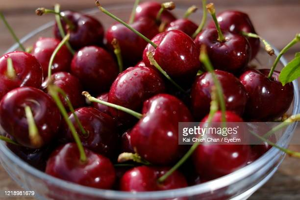 close-up of cherries in bowl - ripe stock pictures, royalty-free photos & images