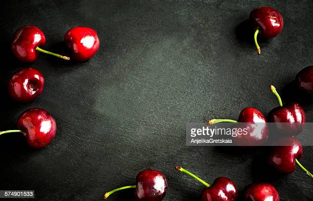 Close-up of cherries on black background