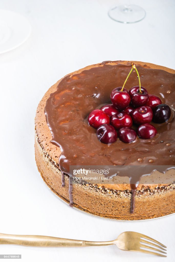 Close-Up Of Cherries On Cake Over White Background : Stock Photo