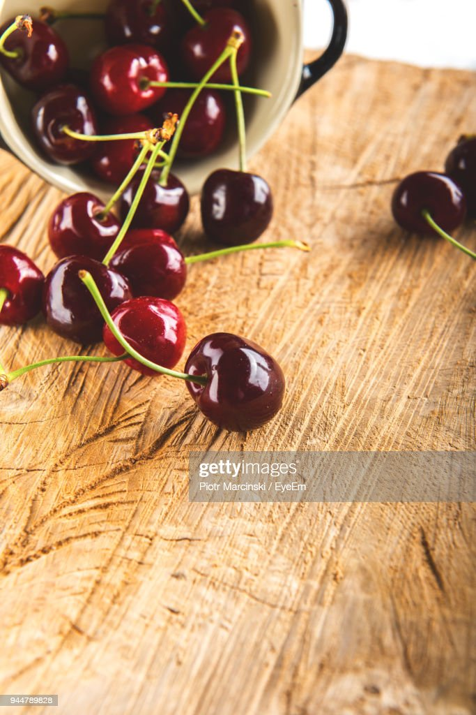 Close-Up Of Cherries On Table : Stock Photo