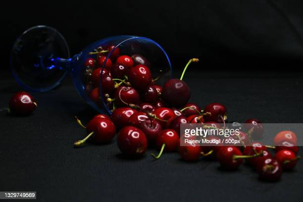 close-up of cherries on table,chandigarh,india - chandigarh stock pictures, royalty-free photos & images