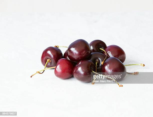 close-up of cherries over white background - jean marc payet stock pictures, royalty-free photos & images