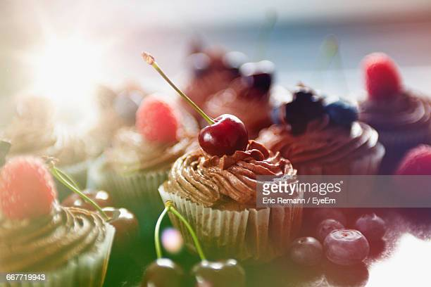 Close-Up Of Cherry On Cupcake At Table