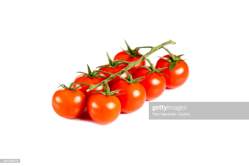 Close-Up Of Cherry Tomatoes Over White Background : Stock Photo