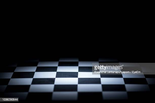 close-up of chess board against black background - chess board stock pictures, royalty-free photos & images