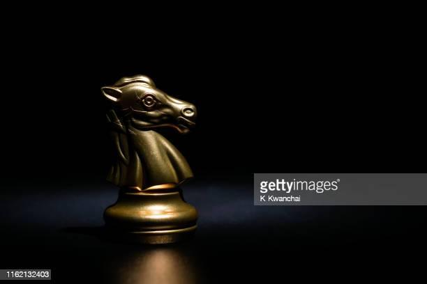 close-up of chess piece on black background - ブツ撮り ストックフォトと画像