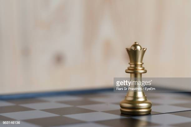 Close-Up Of Chess Piece On Board